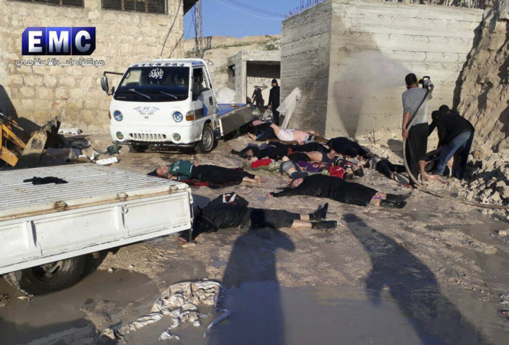FILE - In his photo April 4, 2017 file photo, provided by the Syrian anti-government activist group Edlib Media Center, which has been authenticated based on its contents and other AP reporting, shows victims of a suspected chemical attack, in the town of Khan Sheikhoun, northern Idlib province, Syria. A senior U.S. official says the U.S. has concluded that Russia knew in advance of Syria's chemical weapons attack last week.  (Edlib Media Center, via AP)