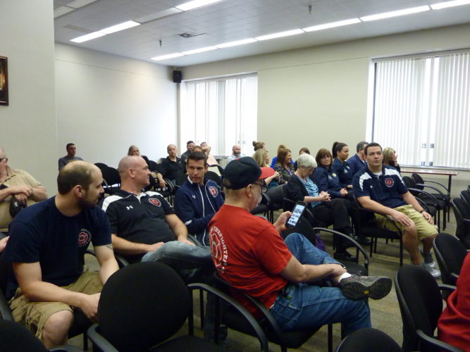 Photos by Linda Comins A large audience awaits the start of the Wheeling-Ohio County Board of Health's public hearing to review the county's clean indoor air regulation Tuesday.