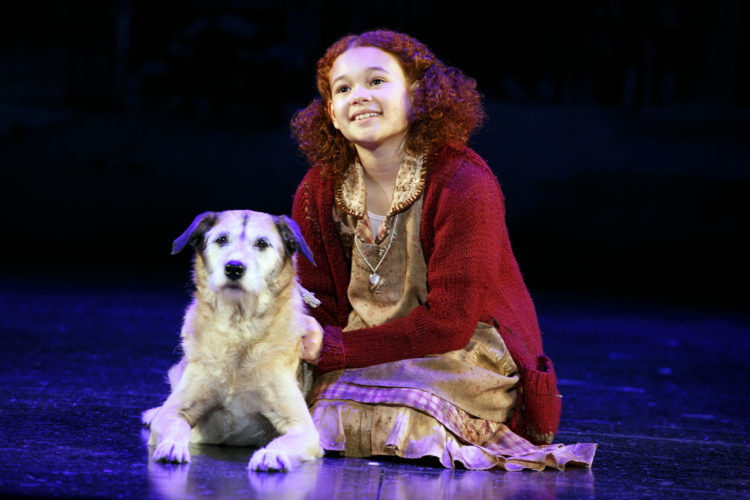 """Orphan Annie, played by Tori Bates, and her dog, """"Sandy,"""" will take the Capitol Theatre stage in Wheeling at 7 p.m. Thursday."""