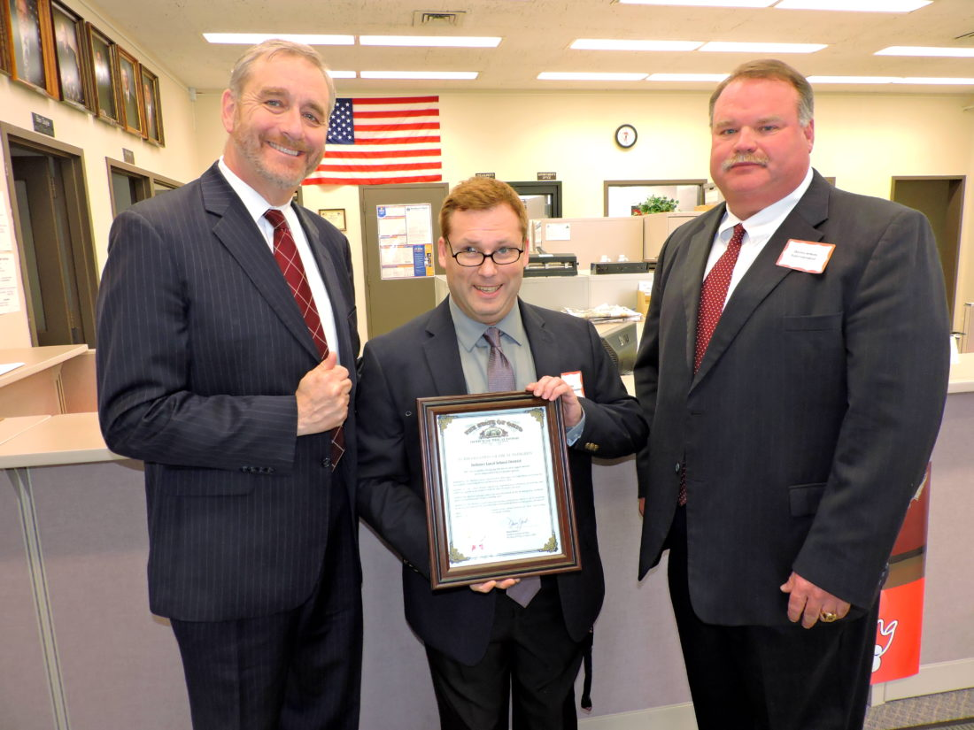 Photo by Shelley Hanson Ohio Auditor Dave Yost, left, presents a certificate of fiscal integrity for the Bellaire Local School District to board of education President Jason Ayers, center, and Superintendent Darren Jenkins on Monday.