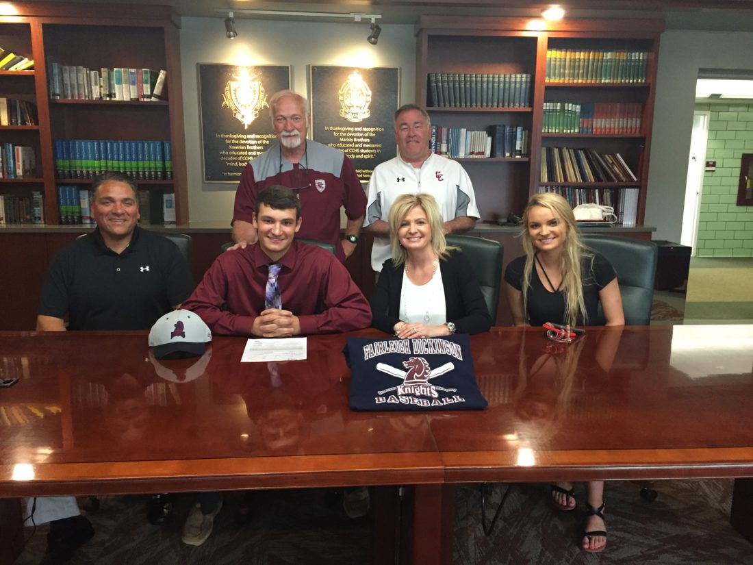 Wheeling Central's Austin Crebs has signed his letter of intent to continue his academic and athletic careers at Fairleigh Dickenson. Austin is flanked by his father, Dave, and mother, Jamie, and sister, Alexa. Standing is Maroon Knights baseball coach Bo McConnaughy and athletics director Mike Young.