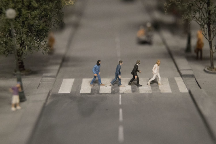 The Beatles crossing Abby Road are depicted in the Europe section of the Gulliver's Gate exhibit, Wednesday, April 5, 2017, in New York. The indoor 49,000-square-foot diorama includes scale models of structures and landscapes from the Brooklyn Bridge and the Eiffel Tower to the pyramids of Egypt and China's Forbidden City, along with the Taj Mahal, Mecca, Niagara Falls and Rio de Janeiro's Christ the Redeemer statue. (AP Photo/Mary Altaffer)