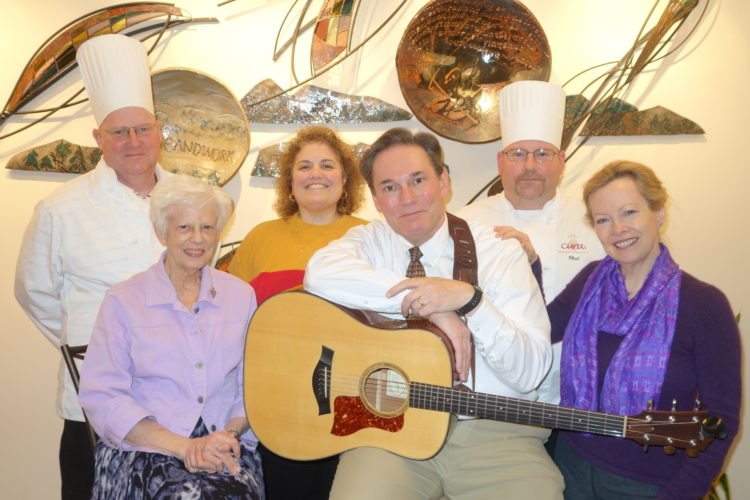 Photo Provided Preparing for this year's French dinner at St. Joseph Retreat Center in Wheeling are, front row from left, Sister Carol Hannig, CSJ, director of community life and services; Bob Gaudio and Clare McDonald; back row from left, Jeff Freshwater, executive chef of Cura Hospitality; Anna Marie Troiani, executive director of St. Joseph Retreat Center, and Chad Calissie, assistant chef for Cura Hospitality.