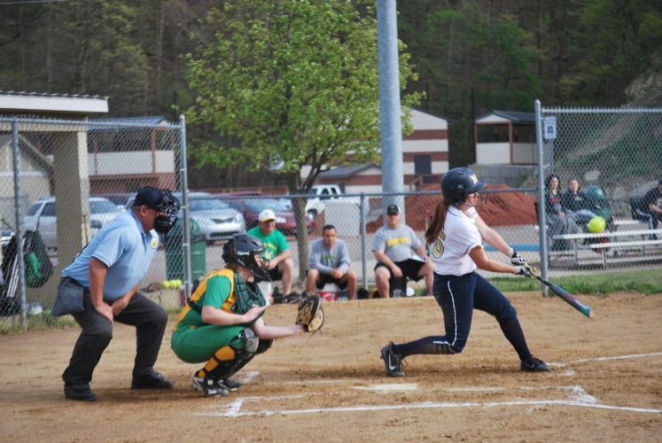 Photo by Kyle Lutz. Magnolia's Ashley Tharp swings at a pitch during Friday's game against Bishop Donahue.