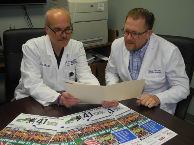 Photo by Ian Hicks Dr. James Comerci, left, director of Wheeling Hospital's family medicine residency program; and Dr. Shawn Stern, Wheeling Hospital medical director, discuss plans for the medical tent at the 41st-annual Ogden Newspapers Half Marathon Classic May 27 in Wheeling.