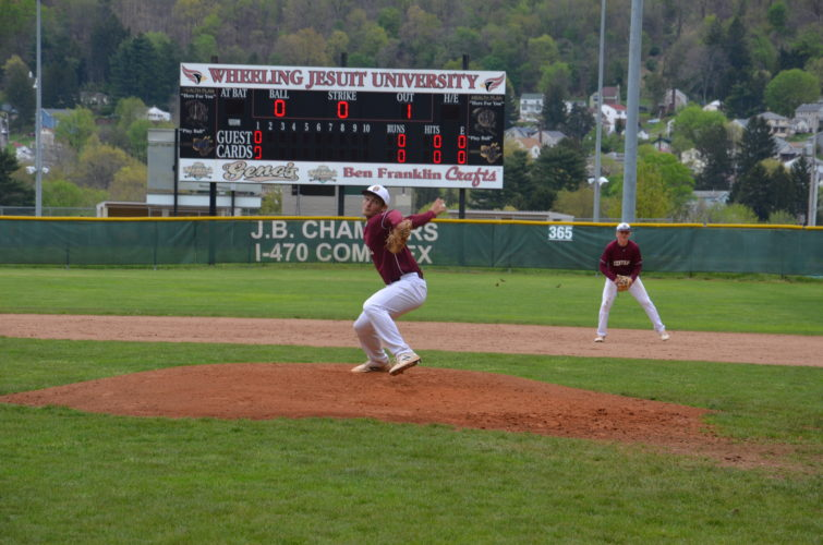 Photo by Kim North Wheeling Central's Austin Crebs delivers to the plate during Saturday's OVAC Class 2A semifinal game against River. The Maroon Knights won, 5-0.