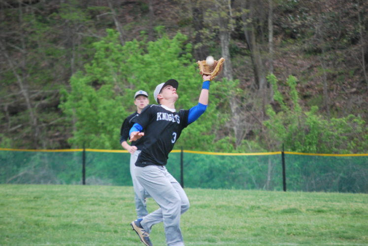 Photo By Cody Tomer Tyler Consolidated's Kyle Mason snags a pop-up during an OVAC contest with Fort Frye.