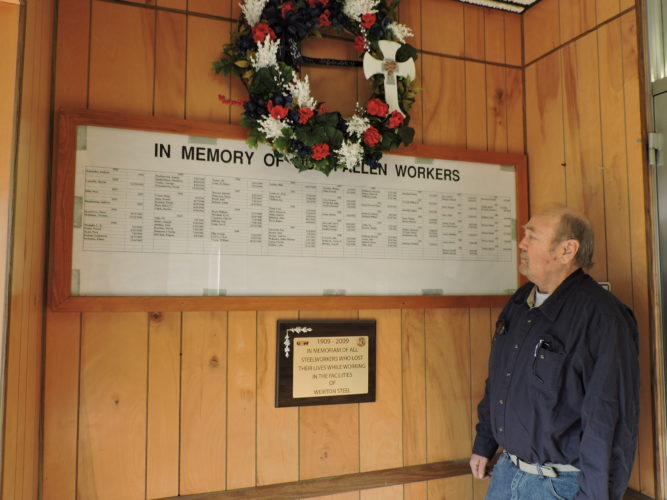 Photo by Dave Gossett United Steelworkers Local 2911 Safety Coordinator Darrell Curtis looks at the list of steelworkers who died on the job at Weirton Steel. The local union will observe Steelworker Memorial Day at 9 a.m. Friday at the Steelworker Memorial Park on County Road in Weirton.