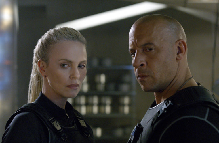 "This image released by Universal Pictures shows Charlize Theron, left, and Vin Diesel in ""The Fate of the Furious."" (Universal Pictures via AP)"