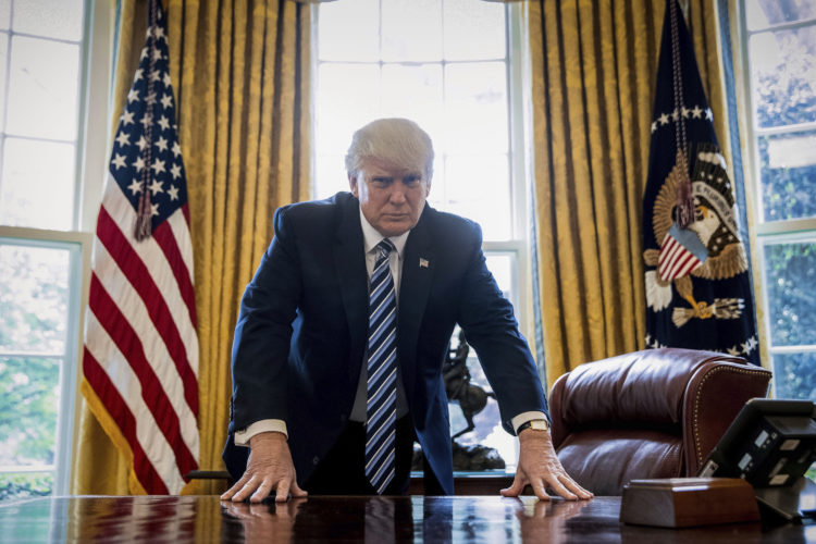 President Donald Trump poses for a portrait in the Oval Office in Washington, Friday, April 21, 2017. With his tweets and his bravado, Trump is putting his mark on the presidency in his first 100 days in office. He's flouted conventions of the institution by holding on to his business, hiring family members as advisers and refusing to release his tax returns. He's tested conventional political wisdom by eschewing travel, church, transparency, discipline, consistency and decorum. But the presidency is also having an impact on Trump, prompting him, at times, to  play the role of traditional president. (AP Photo/Andrew Harnik)