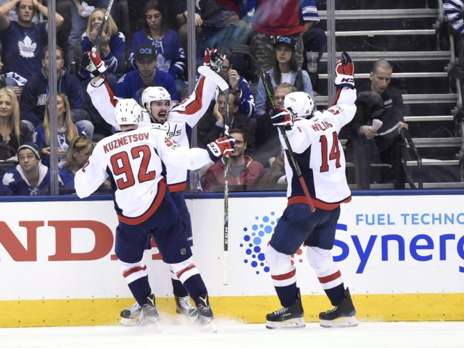Washington Capitals center Marcus Johansson (90) celebrates with center Evgeny Kuznetsov (92) and right wing Justin Williams (14) after scoring against the Toronto Maple Leafs during overtime of Game 6 of an NHL hockey Stanley Cup first-round playoff series in Toronto on Sunday, April 23, 2017. The Washington Capitals beat the Maple Leafs 2-1 on Sunday to capture the best-of-seven Eastern Conference quarter-final series in six games. (Nathan Denette/The Canadian Press via AP)