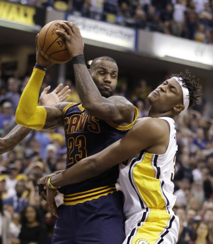 Cleveland Cavaliers' LeBron James grabs a rebound from Indiana Pacers' Myles Turner during the second half in Game 4 of a first-round NBA basketball playoff series, Sunday, April 23, 2017, in Indianapolis. Cleveland defeated Indiana 106-102 and won the series 4-0. (AP Photo/Darron Cummings)