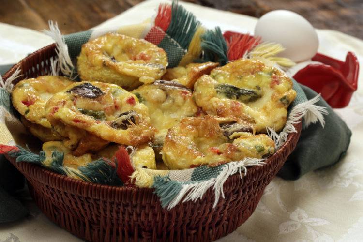 This Jan. 20 photo shows mushroom and asparagus quiche muffins at the Institute of Culinary Education in New York. These frittatas are quick and easy to prepare and can be filled with any of your favorite cheese, vegetable and/or meat combos. This dish is from a recipe by Elizabeth Karmel. (AP Photo/Richard Drew)
