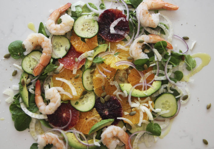 This April 8 photo shows an orange and cucumber salad with shrimp in Coronado, Calif. This dish is from a recipe by Melissa d'Arabian. (Melissa d'Arabian via AP)