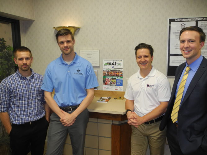 Photo by Ian Hicks Employees at longtime Ogden Newspapers Half Marathon Classic sponsor United Bank, from left, include Jacob Hilton, sales associate; Nathan McKeen, manager; Jared Taylor, sales and service representative; and Tyler Brautigan, financial advisor.