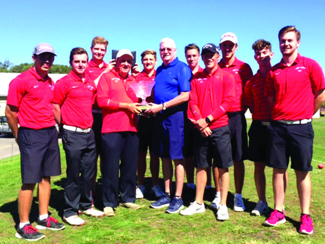The Davis & Elkins College golf team poses with the Wally Edgell West Virginia Division II Collegiate Invitational trophy, held by D&E coach Ed Lothes, left, and Edgell, right, a former D&E coach.