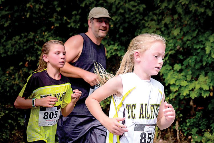 5K runners Rachel Felton and Katie Hicks raised support for Tucker County Youth Softball. (Submitted Photo by David J. Miller)