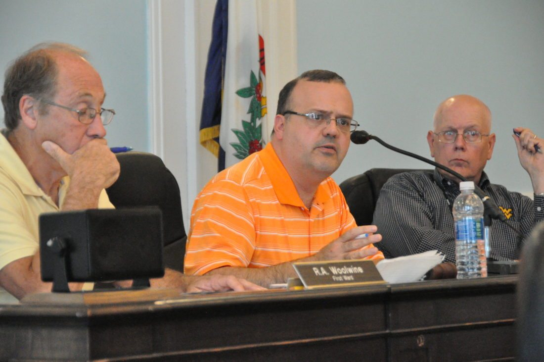 Councilman Mark Scott, center, talks about the Baxter Street Bridge on Wednesday. Also pictured are Councilman Bob Woolwine, left, and Councilman Charles Friddle, right.