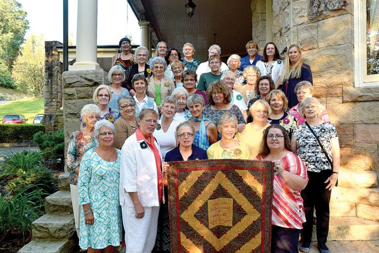 Members of the Log Cabin Quilters' Guild celebrate 30 years with a dinner and show and tell at Graceland Restaurant on the campus of Davis & Elkins College.