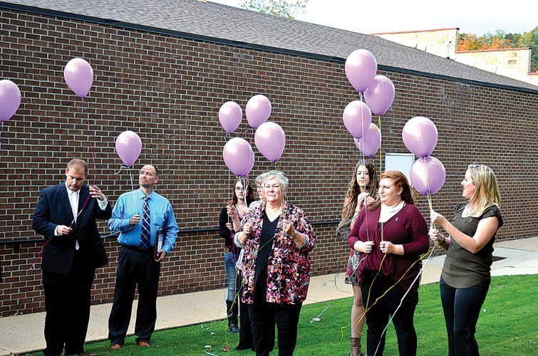 Attendees of a candlelight vigil to honor victims and survivors of domestic violence release balloons on the Randolph County Courthouse lawn Wednesday evening. More than 30 people attended the event, which was sponsored by the Randolph County Prosecutor's Office, Women's Aid in Crisis and the Children's Advocacy Center.