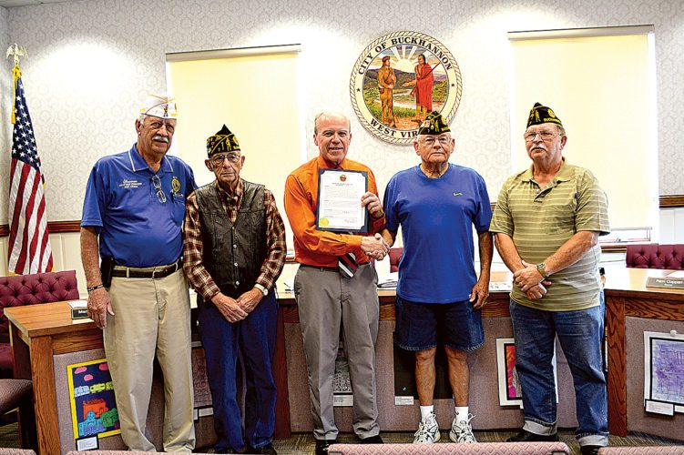 Members of American Legion Post 7 were presented with a proclamation from the City of Buckhannon acknowledging Nov. 11 as Veterans Day. From left are Sherman Baxa, Miles Paugh, Mayor David McCauley, Alfred Roby and Joe Shaver.