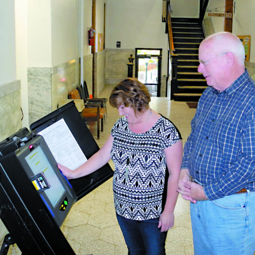 The Inter-Mountain photo by Tim MacVean Randolph County Commission President Mike Taylor, right, and Randolph County Clerk Brenda Wiseman test a voting machine in the Randolph County Courthouse lobby Friday as they prepare for the Nov. 8 election.