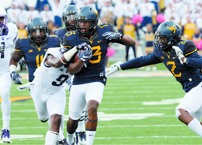 Photos by Brent Kepner/Foto 1 Pro Photo West Virginia University's Rasul Douglas looks for running room in a victory over TCU Saturday.