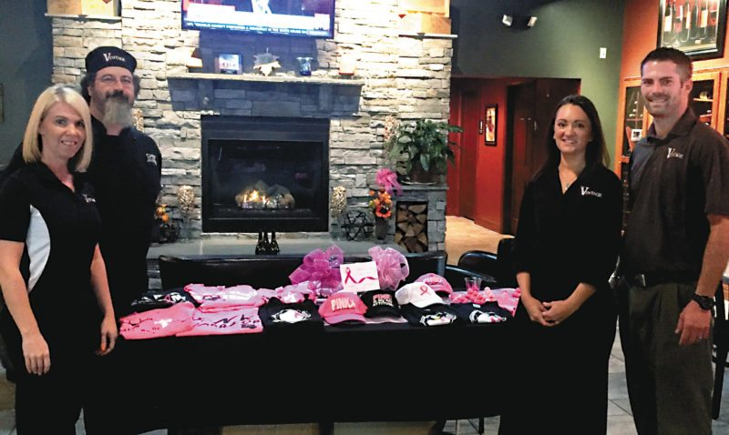 The Inter-Mountain photo by Heather Goodwin Henline An array of breast cancer awareness shirts and hats are available for purchase at Vintage Restaurant and Wine Bar, located at 25 Randolph Avenue. The items were donated by Bev Johnson and 100 percent of the proceeds will be donated to Davis Health System Cancer Foundation. From left are Vintage front of house manager Kathy Canfield, executive chef James DeCarlo, server/bartender Tara Standridge and owner Scotty Marshall.