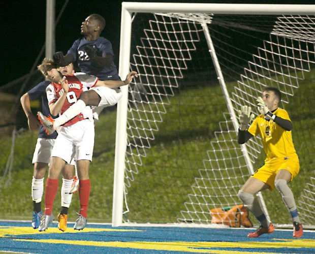 The Inter-Mountain photo by Kevin Hostetler Davis & Elkins freshman Tim Staerz collides in midair with two Alderson Broaddus players during the Senators' 2-0 victory Tuesday night.
