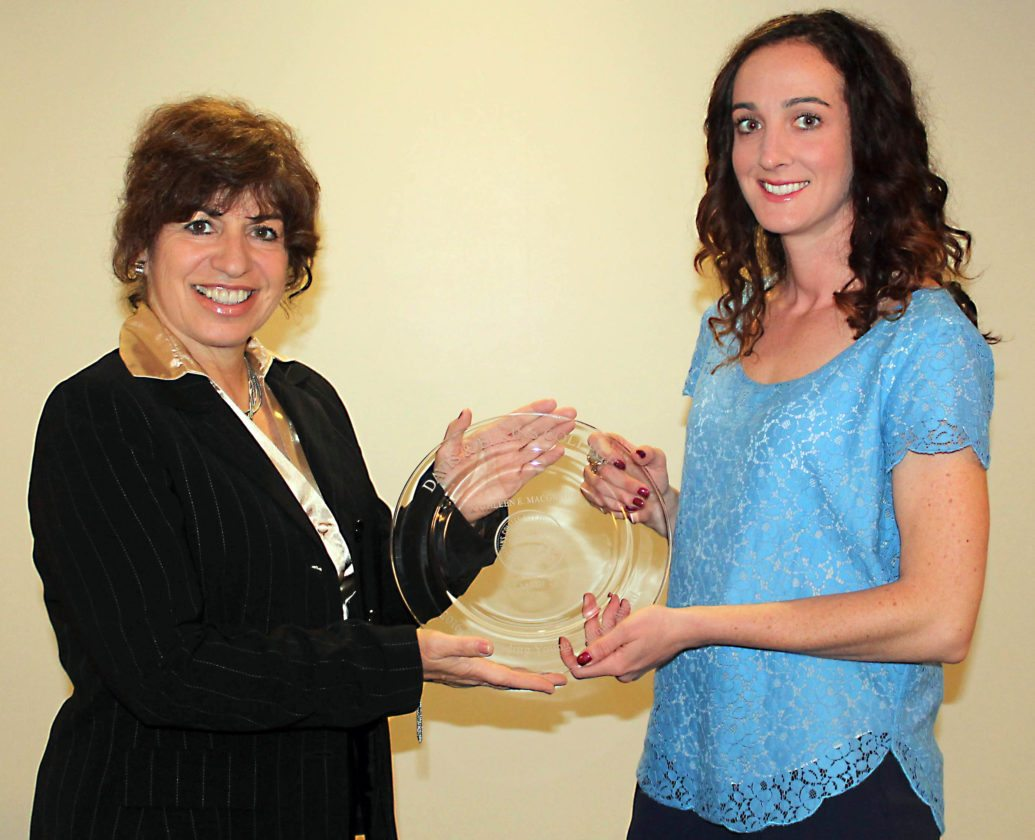 Dr. Mary Ann DeLuca, chair of the Davis & Elkins College Department of Sport Science, left, presents Dr. Katie MacGregor, '08, with the Outstanding Young Alumna Award.