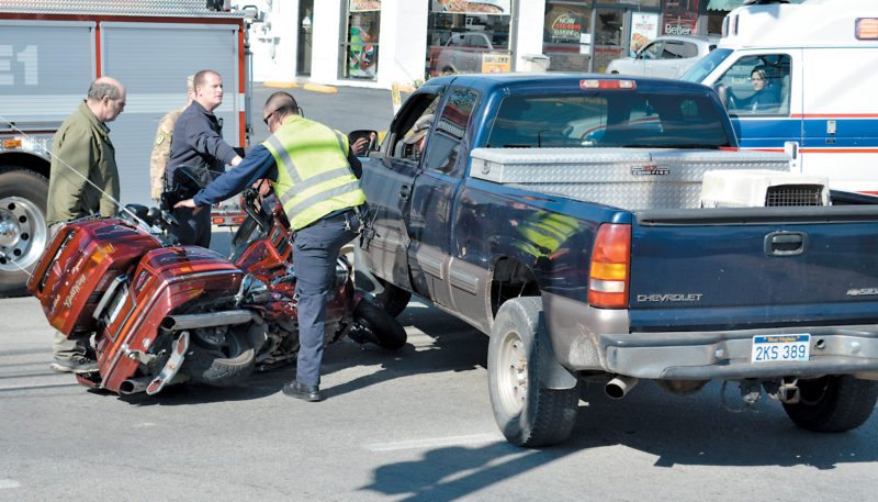 The Inter-Mountain photo by Roger Adkins No one was injured Tuesday when a motorcycle collided with a truck on West Virginia 20 South in Buckhannon. The incident occurred shortly after noon, prompting responses by the Buckhannon Police Department, the Buckhannon Fire Department and Upshur County Emergency Medical Services.