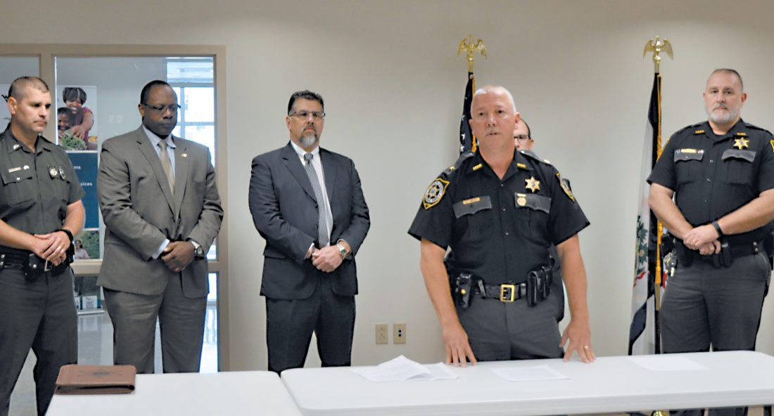 The Inter-Mountain photo by Brooke Binns Randolph County Sheriff Mark Brady announces Wednesday that 28 methamphetamine-related arrests have been made in West Virginia by the Mountain Region Drug and Violent Crime Task Force. Brady, in front, gives particulars about the drug bust during Wednesday's press conference. Back row, from left, are West Virginia State Police First Sgt. G.P. Doyle, Assistant Special Agent in Charge of the ATF for the Louisville Field Division Jon McPherson, Resident Agent in Charge of the AT for Clarksburg Field Office Dewayne Haddix, Tucker County Prosecuting Attorney Ray LaMora and Tucker County Sheriff Brian Wilfong.