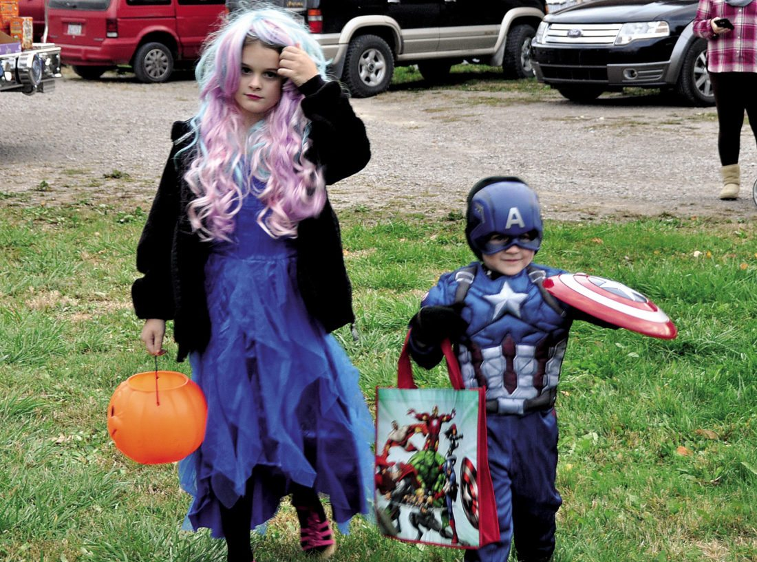 The Inter-Mountain photo by Brooke Binns Characters such as young Captain America visited Clayton Homes of Elkins on Thursday evening. Local businesses and organizations handed out candy as part of a family friendly trick-or-treat night.