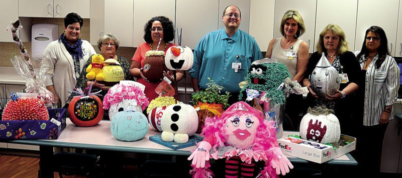 The Inter-Mountain photo by Beth Christian Broschart Members of the Davis Medical Center Culture Club sponsor a pumpkin decorating contest to promote cooperation among the different departments and raise money for the patient assistance fund. Showing the winners and other entries at Davis Medical Center Thursday are, from left, Amanda Smith, Donna Langevin, Cheryl Ramsey, Mark Hamrick, Sabrina Bolton, Jennie Raines and Char Fitzwater.