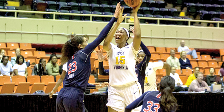 Center Lanay Montgomery puts up a shot for WVU in a recent game. The 6-5 senior racked up 23 points, 18 rebounds and six blocks against Morehead State Wednesday.