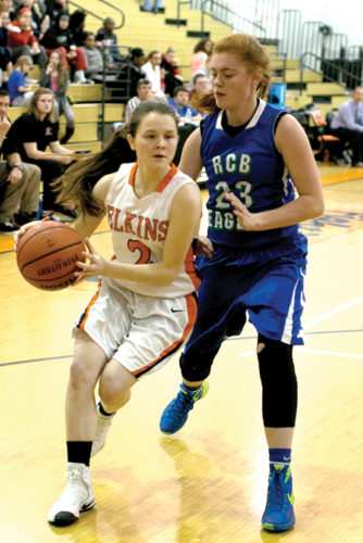 Sophomore Haley Smith drives to the basket for Elkins Thursday.
