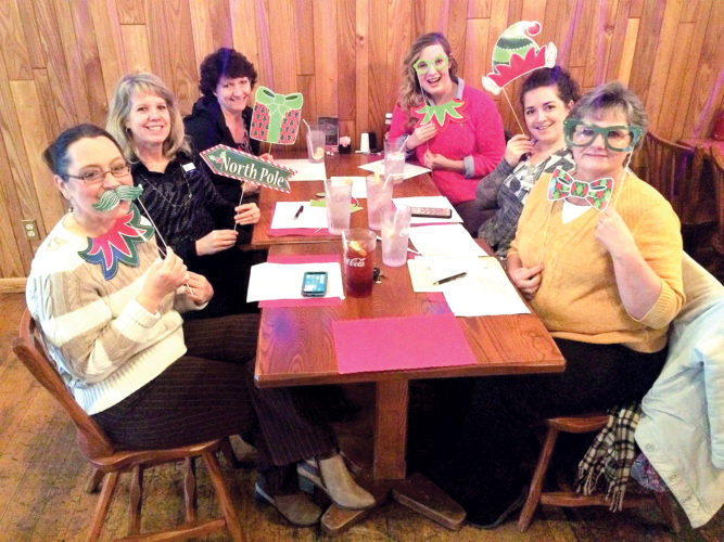 Heather Goodwin Henline, parade committee chair, Kathy Leomburno, Cindee Campbell, Chelsey Jones, Jess Shaffer and Wendy Morgan meet to put the finishing touches on the 2016 ERCCC Christmas parade, set for 6:30 p.m. Wednesday in downtown Elkins.