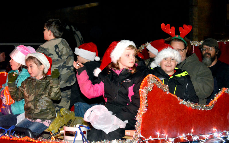 The Inter-Mountain photos by Roger Adkins A group of festive float-riders throw candy from their spot in the Buckhannon Christmas Parade Friday.