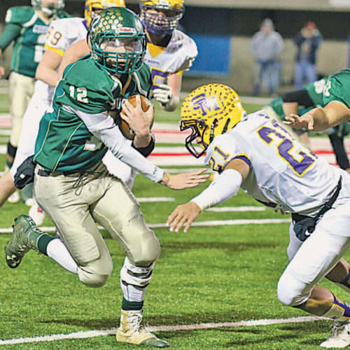 The Intelligencer photo by Alex Kozlowski East Hardy quarterback Corey McDonald (12) tries to avoid St. Marys' linebacker Jaiden Smith (21) in Saturday's W.Va. Class A State Championship