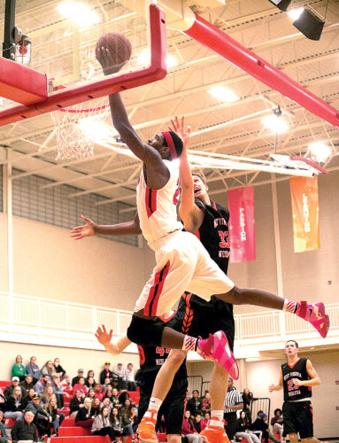 D&E's Kevin Bracy-Davis soars above the rim during the Senators' 79-78 win over West Virginia Wesleyan Monday, D&E's third straight home victory.