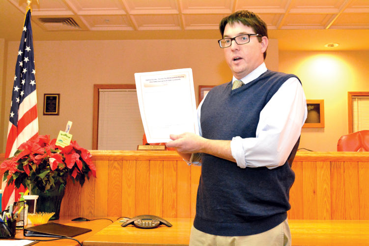 Patrick Kirby of the Northern West Virginia Brownfield Assistance Center goes over comment forms during a meeting Tuesday in Upshur County to discuss possible cleanup of a half acre lot in the Upshur County Youth Camp.