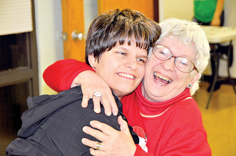 Emily DeMotto, left, and Birdie Stalnaker share an embrace Tuesday night during the 11th annual Friends First Christmas Party at the Randolph County Technical Center.