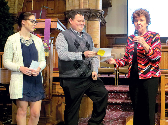 The Davis Memorial Presbyterian Church Women's Scholarship award recently was given to six local students. Emily Caplinger, left, and Matthew Maynard, center, receive their awards from Judy Guye Swanson, scholarship chairman.