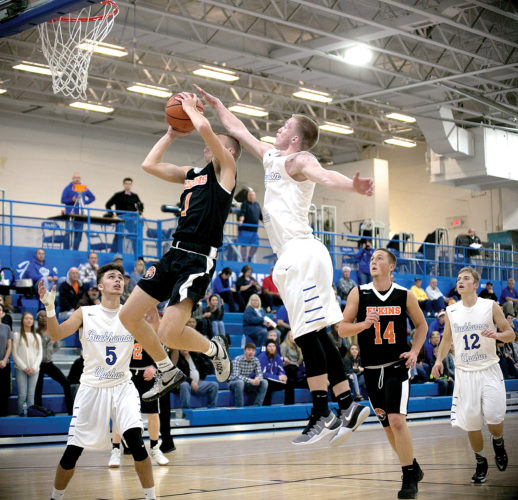 Elkins senior point guard Dalton Hamrick soars to the basket during first half action Thursday night in Buckhannon.