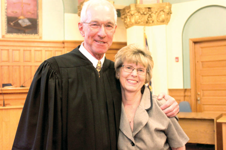 Circuit Judge Alan D. Moats wishes Magistrate Tina Mouser a happy retirement. Mouser retired Friday after 34 years serving the people of Barbour County.