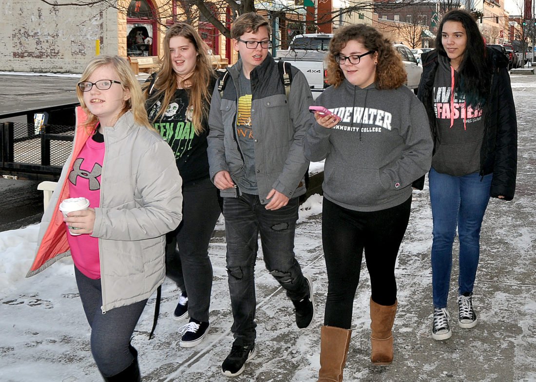 The Inter-Mountain photo by Beth Henry-Vance A group of teenagers walk through downtown Elkins Monday. Elkins Main Street President Mike Bell spoke with the Rotary Club of Elkins about the upcoming The Arts of Elkins event during the group's meeting Monday