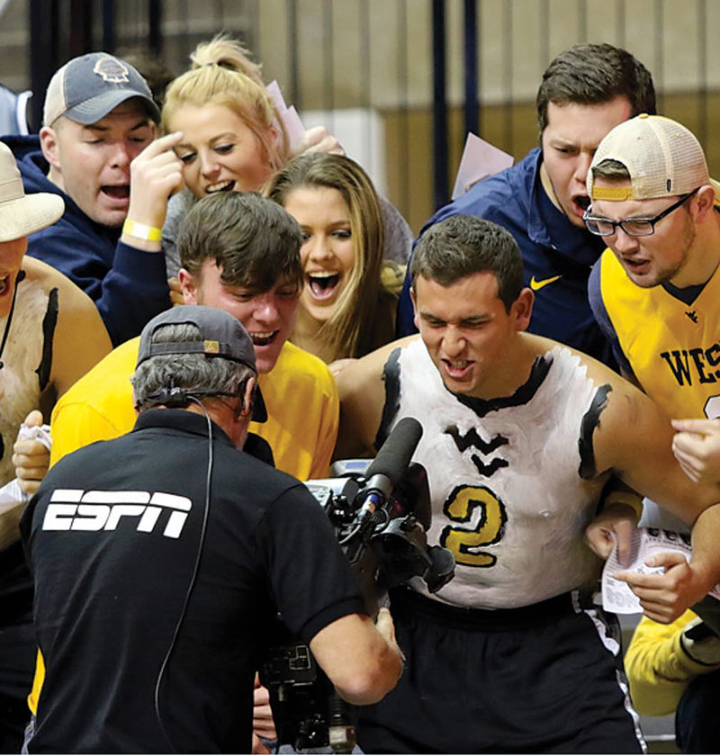 Photo courtesy of Foto 1/Brent Kepner WVU students, above, show their spirit to the ESPN cameras at the Coliseum Tuesday night.