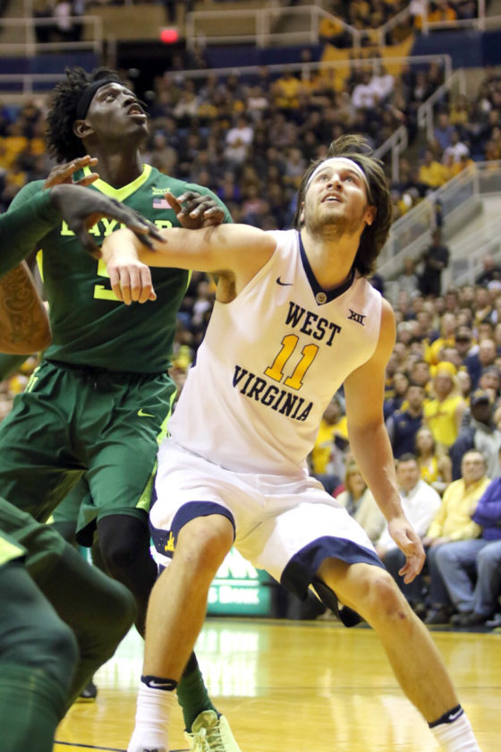 Photo courtesy of Foto 1/Brent Kepner Morgantown native Nathan Adrian, at left, led the Mountaineers with a career-high 22 points Tuesday as WVU defeated top-ranked Baylor 89-68 at the WVU Coliseum.