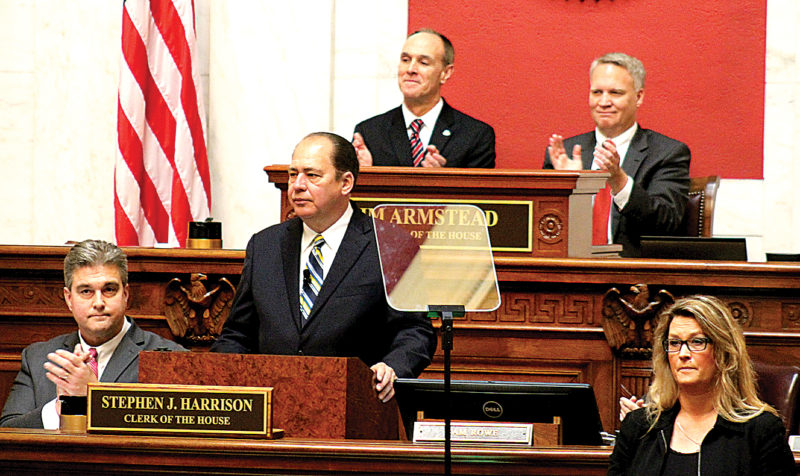 Gov. Earl Ray Tomblin receives a round of applause Wednesday during his farewell address to the 83rd West Virginia Legislature at the West Virginia Capitol in Charleston. Behind Tomblin, Senate President Mitch Carmichael and House Speaker Tim Armstead, both officially confirmed to their positions earlier in the day, applaud the governor.