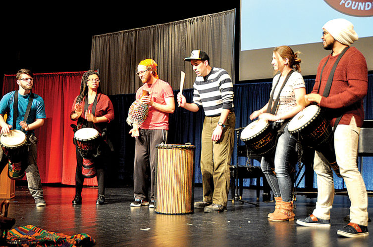 Davis & Elkins College students perform in a drum circle Monday during a service in honor of Martin Luther King Jr. at the college's Harper-McNeeley Auditorium.